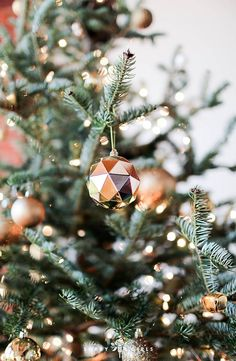 Since the loft has such high ceilings, we finally got to pick out the tallest tree we could find!! Love these gold disco-ball ornaments! Click through for more holiday loft decorating!