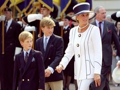 PHOTO: Diana, Princess of Wales and Princes William and Harry attend an event In London on Aug, 19, 1995.