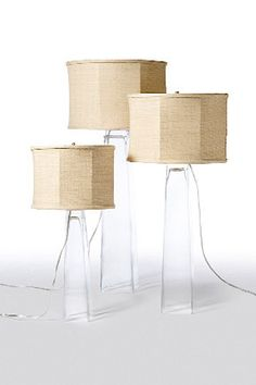 "Square Glass lamps        lamps    $470.00  Square Glass lamps    Square glass lamps with Raw silk shade. Your choice of small, medium or large.  These lamps are a simple sophisticated statement piece.        Small 27"" x12""      Medium 32"" x 15""      Large 36"" x 17"""
