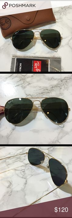 NWOT Authentic Ray-Ban Polarized Aviators This pair of authentic polarized Aviator Classic Ray-Bans with gold framing and green classic lenses are new and never used. The sunglasses come with the original brown Ray-Ban case and the lens cloth still it its plastic covering. The glasses are in nearly perfect condition with the exception of one very slight scratch depicted in the last photo bear the top inside corner of one lens. This small scratch is hardly visible even when looking up close…