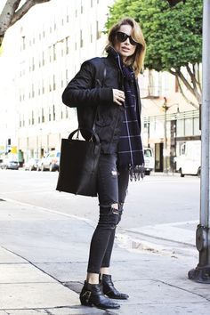 Anine Bing is rocking a monochrome bomber jacket look consisting of edgy studded ankle boots, distressed denim jeans, and a gorgeous statement scarf. We love this look for its simplicity and...