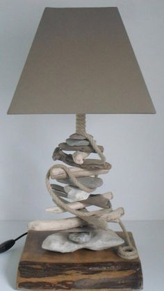 handmade lamp created with driftwood, pebbles and rope. Driftwood Lamp, Ikea Lamp, Bohemian Living Rooms, Table Lamps For Bedroom, Handmade Lamps, Wooden Lamp, Crackle Glass, Unique Lamps, Design Your Home