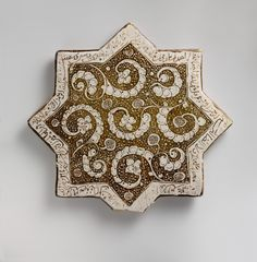 Star-Shaped Tile Object Name: Star-shaped tile Date: dated A. luster-painted on opaque white glaze Dimensions: Max. (point to point) 12 in. Tile Art, Mosaic Art, Mosaic Tiles, Mosaics, Islamic Tiles, Islamic Art, Ancient Persian, Antique Tiles, The Originals