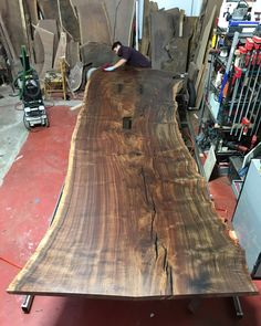 Putting the finishing coat on this 16' Claro Walnut behemoth.