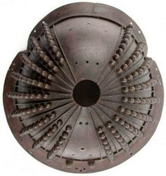 20 plate o-boshi suji bachi kabuto, Kamakura period, 1185-1333, russet iron finish with 162 standing rivets (Hoshi) within iron plates (ken), gradually reducing in size to the top of each plate.