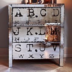 what a cool piece of furniture! drawers, mirror, print, vintage feel...