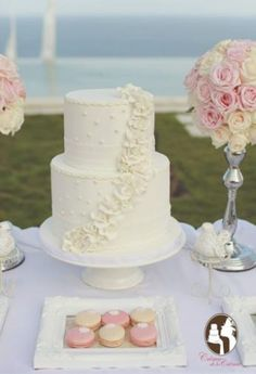 Preety three tier white wedding cake. more ideas :  www.bridestory.com