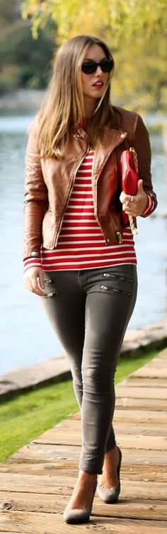 Army green skinnies with red stripes and luggage colored leather