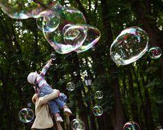 A child reaches for big bubbles in Kiev