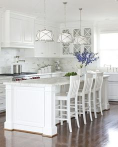 Perfect kitchen on every level, with special mention to the pendant lights - wow. white kitchen by Sally de Sayan