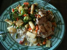 Pan-cooked veggies with chicken on a bit of whole grain rice with hemp seeds