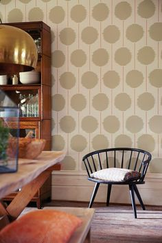 A contemporary wallpaper by Scion featuring large circles and lines.