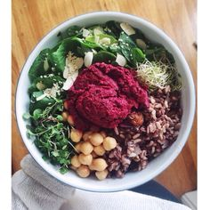 Buddha bowl {butter lettuce • watercress • mixed green sprouts • chickpeas • homemade wild rice, lentil, golden cranberry mix • homemade beet hummus} // posting the beet hummus recipe later tonight on my blog #whatveganseat #plantpowered