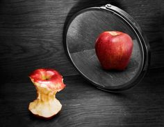 Rotting apple reflection