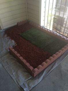 Lay One Roll Of Sod, And 1/4 Bag Of Red Bark Chips Over