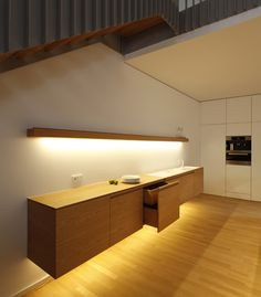 Putting a kitchen under the stairs is a great idea, for many reasons. If you have the space, or could get rid of your stairs' skirt, it's definitely something...