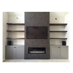 lose the tv and replace with a huge black and white horse canvas and paint the cabinetry white and it is perfect