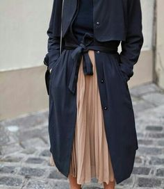 navy trench and pleated skirt