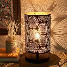 Accentuate the charm of your bedroom by placing this appealing table lamp. Featuring an eye-catching circular pattern, it will add class and appeal to your home decor. It also makes for a wonderful gifting item.  * Material: Sheet Metal  * Color: Black & Gold  * Shade Height: 11.7 inches (29 cm)  * Shade Diameter: 8 inches (20 cm)  * Stand Height: 3.2 inches (8 cm)  * Base Diameter: 8 inches (20 cm)  * Height: 15 inches (38 cm)  * Lighting Part: Bulb  * Number of Bulbs Req…
