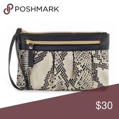 "Snakeskin Wristlet Perfect for a night on the town. Carry this faux-snakeskin wristlet in style. Faux-snakeskin texture Silver-tone hardware Product Details 5""H x 7 1/2""W x 1/2"" D Detachable wrist strap Zipper closure Exterior: zip pocket Interior: 6 card slots, slip pocket & zip pocket Faux leather Apt. 9 Bags Clutches & Wristlets"