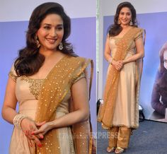 Promoting her upcoming film 'Dedh Ishqiya' Madhuri in a dull bronze salwar suit with a hint of shimmer. Gold strappy sandals and jewelry to match added to her look! (IE Photo: Varinder Chawla)
