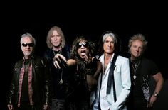 """Aerosmith's next tour, possible new disc, waiting on singer Steven Tyler's solo project, band members say  Rock and Roll Hall of Fame group Aerosmith plans to tour again this summer, and some band members hope they group can at some point this year get into the studio to start work on a follow up to its 2013 album """"Music From Another ..."""
