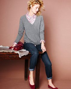 printed button down shirt, gray sweater, bright shoes
