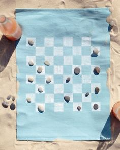 Use a placemat for the game board.  Instructions here are complete and checkers can be played on one side, tic-tac-toe on the other.  And....it fits in a shoe box beautifully!!