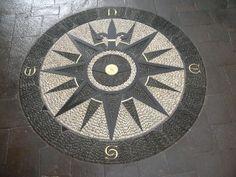 Compass Rose - Stone mosaic by John Botica