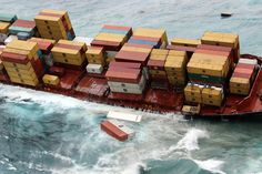 Shipping containers and bunker fuel spill from the container ship Rena off the coast of New Zealand.