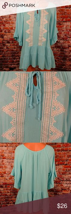 Boho Tunic Top Comfy casual turquoise lace accent front tie neckline blouse. Tiered at bottom ruffle sleeve. Size XL. 100% rayon gauze. Made in the US. 23 inches across China Kama 27 inches long. Perfect with my fleece lined sand leggings available @imthedesertdiva. Westbound Tops Blouses