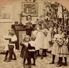 Children having a Christmas dance as a little boy fiddles, 1897.