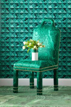 """Emerald : My favorite color . . .""""Malachite"""" wall covering from Rinekwall sets the stage for this rich vignette. A chair upholstered in Jim Thompson's """"Gemstone"""" is a tribute to Tony Duquette, available from Ceylon et Cie."""