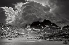 """This """"dark and stormy"""" towering mountain peak in the Sierra Nevada captures the sun and the storm as the weather shifts. (Photo: Peter Essick/National Geographic)"""