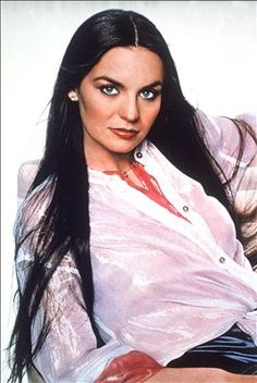 """Crystal Gayle (born: January 9, 1951, Paintsville, KY, USA) is an American country singer. She is best known for her country-pop crossover hit song, """"Don't It Make My Brown Eyes Blue"""" (1977). She had 20 number one country hits during the 1970s and 1980s and 6 albums certified gold by RIAA. She is the younger sister of Loretta Lynn. She was awarded Female Vocalist Of The Year in 1977 and 1978 at the Country Music Association Awards."""