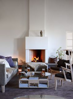 Hotels & Lodging: Kafferosteriet in Österlen, Sweden (Remodelista: Sourcebook for the Considered Home) Cozy Living Rooms, Living Room Modern, Living Spaces, Cafe Interior, Interior Design, White Washed Floors, Fireplace Accessories, Fireplace Design, Home Furniture