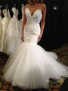 Love Simone Carvalli wedding dresses. Very sexy and pinup without being vulgar. Like something Marilyn Monroe or Jayne Mansfield would walk the red carpet in. Actually their signature mermaid silhouette reminds me of Jayne Mansfield wedding dress.