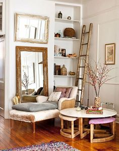Distressed mirrors, a ladder leaning against the wall, chaise lounge...makes a lovely composition.
