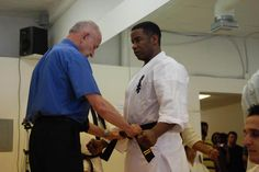 Coolness a picture of Michael Jai White receiving his Nidan Rank. Awesome!
