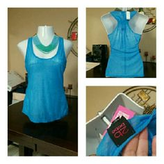 Bebe Light Blue Sheer Tank Top Tunic Size Large BRAND SPANKING NEW, Bebe Light Blue Sheer Tank Top Tunic Size in Size Large. Perfect Summer Tank or can be worn underneath Suit Jacket for a little color at work. Retail $30.00 Bebe Tops Tank Tops