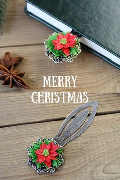 Bookmark with cute poinsettia is a perfect holiday gift for nature lover, book lover, gardener, biologist, teacher, student, mom, grandma etc.Flower is made of air dry polymer clay completely by hand. #christmasgift #book #bookmark #giftideas