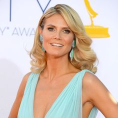 Heidi Klum: Heidi Klum arrived at the Emmy Awards in an up-to-there dress, which she paired with a glamorous blowout and shimmering eye shadow.