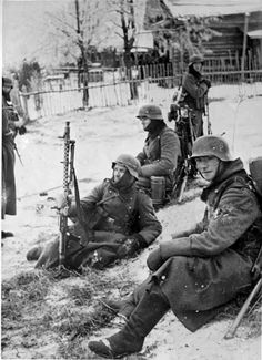 German soldiers during the Battle of Moscow. The man in the middle is holding up an MG34 machine gun.