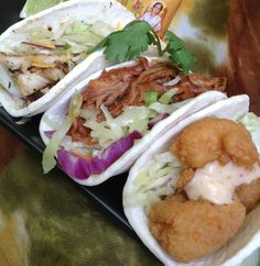 Café Caribe's Taco Slider Trio: A sampler of 3 bite-size tacos: grilled jerk chicken with cheese; pulled pork smothered in a tangy BBQ sauce; and crunchy shrimp topped with creamy chipotle sauce. All are garnished with citrus slaw. @ Café Caribe's