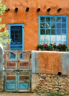 santa fe style -old doors against adobe walls -doors from all over the world patina under the desert sun -