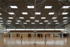 Joaquim Carvalho Secondary School / Inês Lobo Arquitectosm, gym, truss, wood floors, skylights