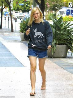 Casual: Seen out and about in LA on Tuesday, Elle Fanning went for a laid back look