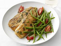 Versatile tilapia is coated in a flour-and-herb mixture, fried until crispy and served with lemony green beans for a light but satisfying springtime dinner.