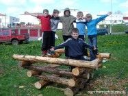 outdoor play log stack