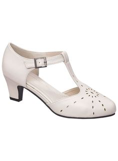 "T-strap pump with cutout-detailed upper and an adjustable buckle closure with hidden stretch. Cushioned insole. Lightweight outsole. 2"" heel. Urethane. Imported. In whole and half sizes. 10,11,12 whole sizes only."